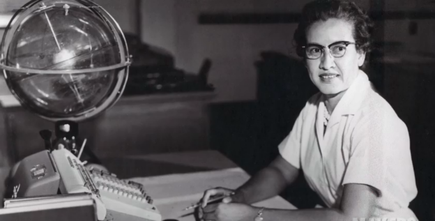 Katherine Johnson sits at her desk with a globe or 'Celestial Training Device' credits: NASA
